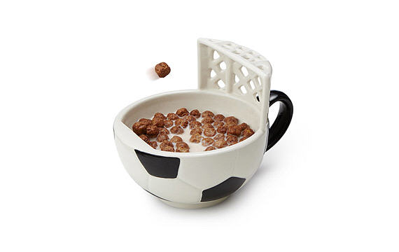 A mug with a soccer goal net on the side.