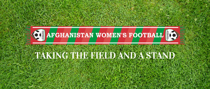 Afghanistan women's national soccer team red and green scarf laying on grass
