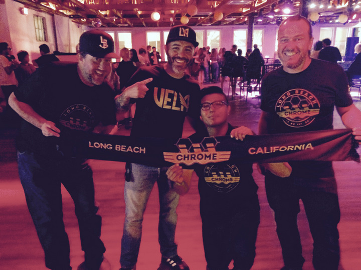 Long Beach Chrome members holding supporter scarves