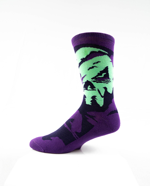 purple, green and black sock standing up on white background