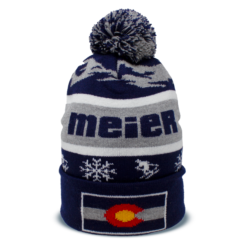 blue, grey, and white pom beanie with printed snowflakes, skiers and Colorado flag on the front designed by Diehard Custom
