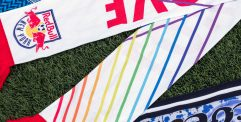 three customized scarves displayed on a turf field