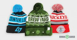 three pom beanies side by side designed by Diehard Custom