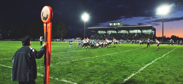 a chilly fall night on the football field during a game.
