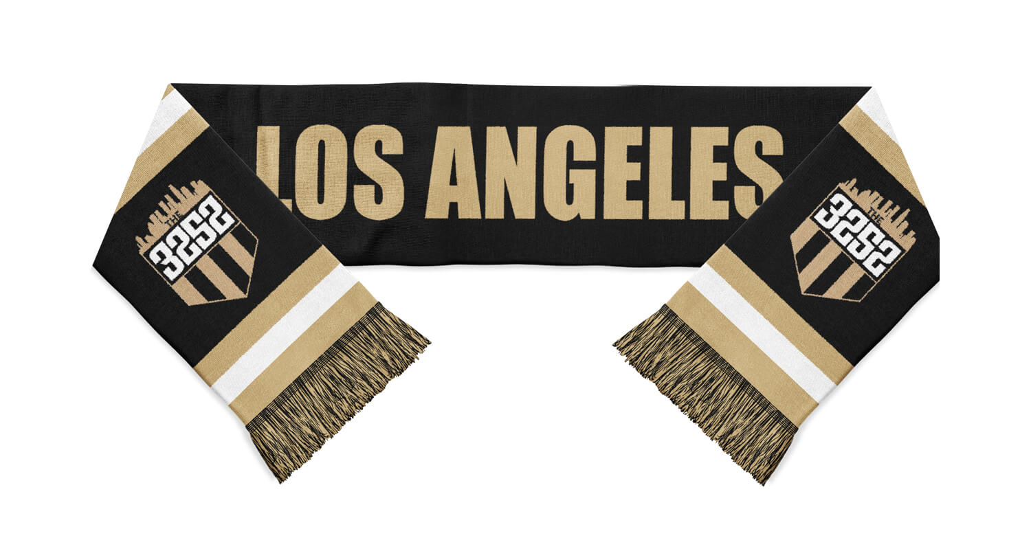 tan, white and black the 3252 soccer supporters scarf with Los Angeles written in white in the center