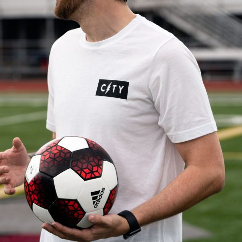man wearing a Diehard Custom white t-shirt with a black