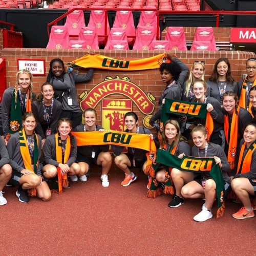 Athletes from Manchester CBU show off their custom scarves in a team photo