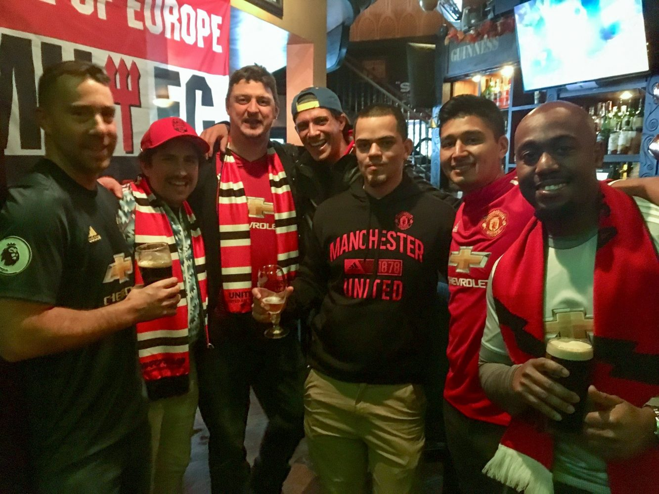 Manchester United supporter group celebrating in bar