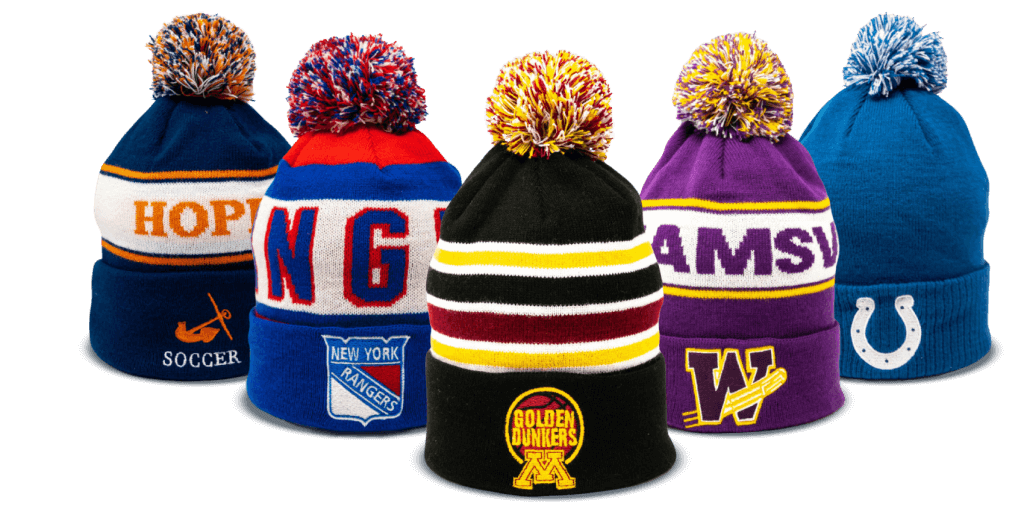 Hope Soccer, New York Rangers, Golden Dunkers, and Indianapolis Colts pom beanies stacked in front of one another designed by Diehard Custom