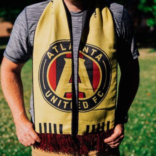 man wearing an Atlanta United FC soccer scarf outside - Diehard Custom Scarves